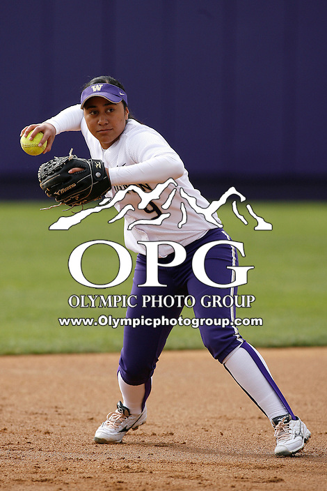 14 March 2010:  Washington Huskies #9 Jerrin Fa'asua warms up before the game against Seattle University. Washington defeated Seattle University 8-3 at Husky Softball Stadium in Seattle, WA.