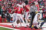 Wisconsin Badgers wide receiver A.J. Taylor (4) celebrates a touchdown pass with teammates during an NCAA College Big Ten Conference football game against the Michigan Wolverines Saturday, November 18, 2017, in Madison, Wis. The Badgers won 24-10. (Photo by David Stluka)