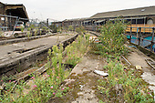 Derelict railway tracks on land behind Kings Cross station in central London.  Small businesses using the decaying warehouses in the old goods yard are likely to be evicted when major redevelopment begins.