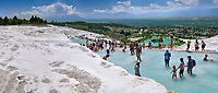 Tourists bathing in the travatine pools oand thermal waters of Pamukkale. Turkey