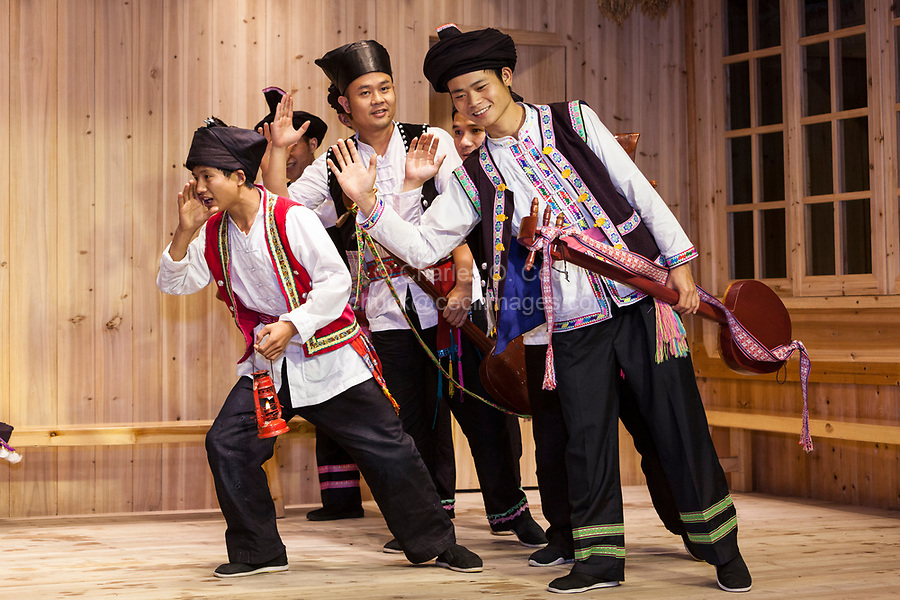 Zhaoxing, Guizhou, China.  Young Men Acting a Story in a Traditional Musical Performance by Members of the Dong Ethnic Minority.