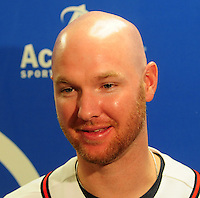 Pitcher Jonny Venters of the Atlanta Braves talks with a reporter on January 27, 2012 at Academy Sports and Outdoors in Spartanburg, South Carolina. It was the first day of the 2012 Braves Country Caravan, which visits cities all across the South prior to Spring Training. (Tom Priddy/Four Seam Images)