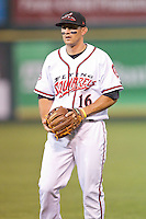 Myles Schroder (16) of the Richmond Flying Squirrels warms up in the outfield prior to the game against the New Hampshire Fisher Cats at The Diamond on June 13, 2014 in Richmond, Virginia.  The Fisher Cats defeated the Flying Squirrels 6-3.  (Brian Westerholt/Four Seam Images)