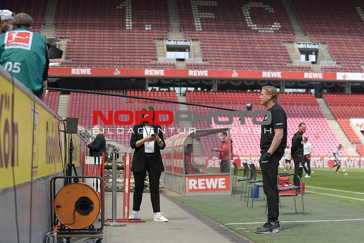 nph00351: Markus GISDOL (Trainer 1.FC Koeln) <br /> beim Interview vor Anpfiff.<br /> Sport: Fussball: 1. Bundesliga: Saison 19/20: 26.Spieltag: 1.FC KOELN-FSV MAINZ 05,17.05.2020.<br /> <br /> Nur für journalistische Zwecke! Only for editorial use!<br /> Gemäß den Vorgaben der DFL Deutsche Fußball Liga ist es untersagt, in dem Stadion und/oder vom Spiel angefertigte Fotoaufnahmen in Form von Sequenzbildern und/oder videoähnlichen Fotostrecken zu verwerten bzw. verwerten zu lassen. DFL regulations prohibit any use of photographs as image sequences and/or quasi-video.<br /> <br /> Foto: Anke Waelischmiller/SVEN SIMON/POOL/via Meuter/nordphoto
