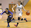 Kacey Burden #27 of Carle Place, right, looks to dribble past Faith Smith #21 of Oyster Bay during the Nassau County varsity girls basketball Class B final at LIU Post on Thursday, Feb. 18, 2016. Burden scored a team-high 27 points to lead Carle Place to a 62-58 victory in overtime.