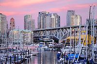 Vancouver area of Granville bridge showing apartment, office blocks marina at dusk. British Columbia, Canada