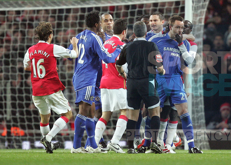 Arsenl's Emmanuel Eboue grabs Chelsea's John Terry after his tackle on Cesc Fabregas