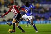 1st November 2017, St. Andrews Stadium, Birmingham, England; EFL Championship football, Birmingham City versus Brentford; Cheick Ndoye of Birmingham City stretches through the legs of Andreas Bjelland of Brentford for the ball