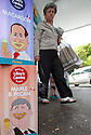 A young boy with his dad spots an eat ice cream advert using a cartoon's of French President Francois Hollande, Canadian Prime Minister Stephen Harper and other G8 leaders outside a petrol station close to the G8 Summit in Lough Erne, Northern Ireland, Britain, 18 June 2013. Leaders from Canada, France, Germany, Italy, Japan, Russia, USA and UK are meeting at Lough Erne in Northern Ireland for the G8 Summit 17-18 June. The leaders were holding their second and final day of talks on 18 June, with the global economy and tax avoidance high on the agenda.  Photo/Paul McErlane