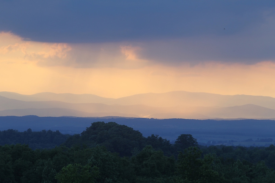 A sunset scenic view of the Shenandoah National Forest and the Blue Ridge mountains from Orange County, VA. Photo/Andrew Shurtleff