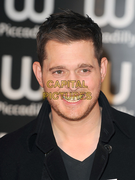 Michael Buble.Canadian Grammy Award-winning artist  signs copies of his new illustrated memoir, 'On Stage, Off Stage', Waterstones Piccadilly, London, UK,.14th October 2011..Book photocall  portrait headshot black stubble facial hair smiling .CAP/BEL.©Tom Belcher/Capital Pictures.