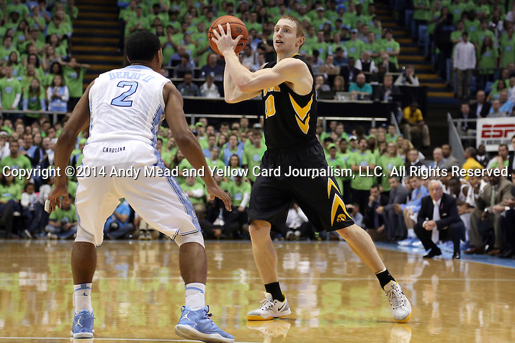 03 December 2014: Iowa's Mike Gesell (10) and North Carolina's Joel Berry II (2). The University of North Carolina Tar Heels played the University of Iowa Hawkeyes in an NCAA Division I Men's basketball game at the Dean E. Smith Center in Chapel Hill, North Carolina. Iowa won the game 60-55.