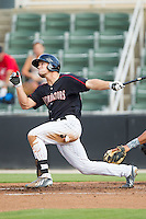 Adam Engel (23) of the Kannapolis Intimidators follows through on his swing against the Asheville Tourists at CMC-NorthEast Stadium on July 13, 2014 in Kannapolis, North Carolina.  The Tourists defeated the Intimidators 8-2.  (Brian Westerholt/Four Seam Images)