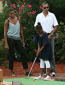 United States President Barack Obama and First Lady Michelle play miniature golf with daughter Sasha at Pirate's Island Miniature Golf in Panama City Beach, Florida USA on Saturday, 14 August  2010.  The First Family is visiting the area to help promote tourism and check up on clean up efforts from the aftermath of the Deepwater Horizon Oil spill.  .Credit: Dan Anderson / Pool via CNP