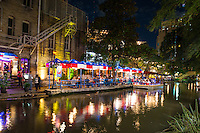 We capture this night in San Antonio on the river walk ofpeople dinning at the Republic of Texas restaurant along the river walk.  There is also a tour boat getting ready for a tour and dinner along the river walk.