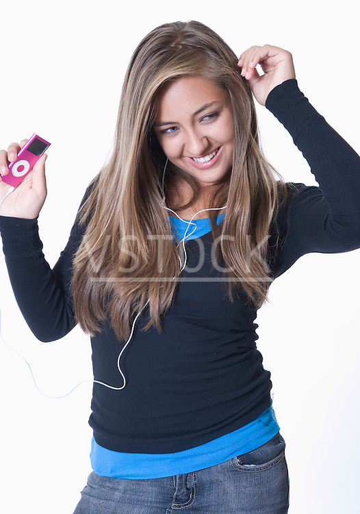 Teenage girl listening to ipod, dancing