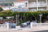Restaurant and hotel Villa Vrogorac with outside seating terrasse under pergola on the coast of Peljesac peninsula near Orebic Peljesac peninsula. Dalmatian Coast, Croatia, Europe.
