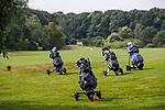 Golftassen op trolleys