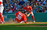9 June 2012: Washington Nationals outfielder Michael Morse slides home safely as Ryan Zimmerman looks on during a game against the Boston Red Sox at Fenway Park in Boston, MA. The Nationals defeated the Red Sox 4-2 in the second game of their 3-game series. Mandatory Credit: Ed Wolfstein Photo