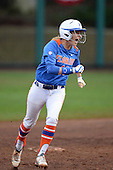 Florida Gators first baseman Taylor Schwarz (49) celebrates as she runs the bases after after hitting a home run during a game against the Michigan Wolverines on February 8, 2014 at the USF Softball Stadium in Tampa, Florida.  Florida defeated Michigan 9-4 in extra innings.  (Copyright Mike Janes Photography)