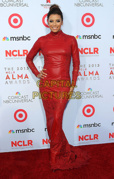 Eva Longoria<br /> 2013 NCLR ALMA Awards held at Pasadena Civic Auditorium, Pasadena, California, USA, 27th September 2013.<br /> full length red leather long high neck sleeve dress hand on hip lace <br /> CAP/ADM/KB<br /> &copy;Kevan Brooks/AdMedia/Capital Pictures