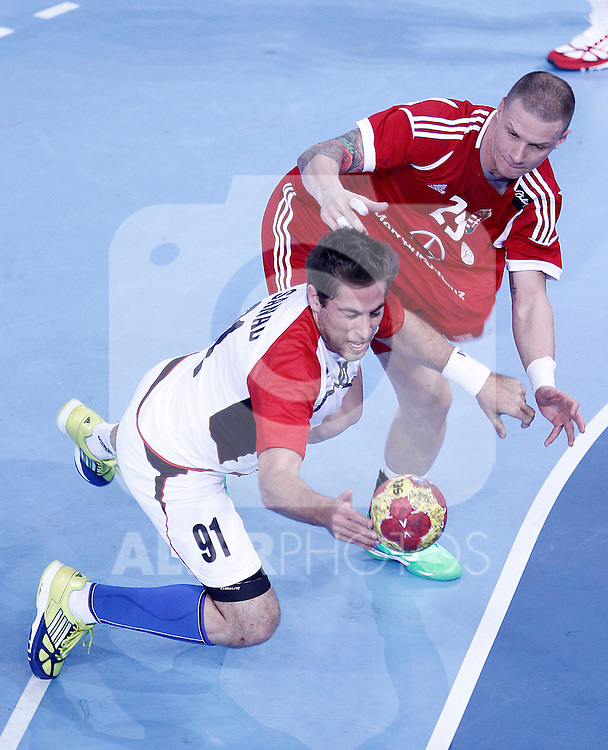 Hungary's Szabolcs Zubai (r) and Egypt's Mohamed Hisham during 23rd Men's Handball World Championship preliminary round match.January 12 ,2013. (ALTERPHOTOS/Acero)