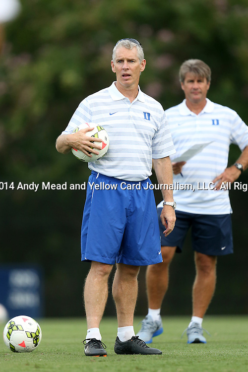 19 August 2014: Duke assistant coach Michael Brady with head coach John Kerr (behind). The Duke University Blue Devils hosted the Radford University Highlanders at Koskinen Stadium in Durham, NC in a 2014 NCAA Division I Men's Soccer preseason match.