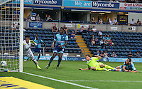 Chris Porter of Colchester United scores his goal 1 0 during the Sky Bet League 2 match between Wycombe Wanderers and Colchester United at Adams Park, High Wycombe, England on 27 August 2016. Photo by Andy Rowland.