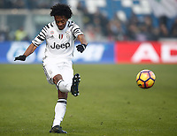 Calcio, Serie A: Sassuolo vs Juventus. Reggio Emilia, Mapei Stadium, 29 gennaio 2017. <br /> Juventus&rsquo; Juan Cuadrado kicks the ball during the Italian Serie A football match between Sassuolo and Juventus at Reggio Emilia's Mapei stadium, 29 January 2017<br /> UPDATE IMAGES PRESS/Isabella Bonotto