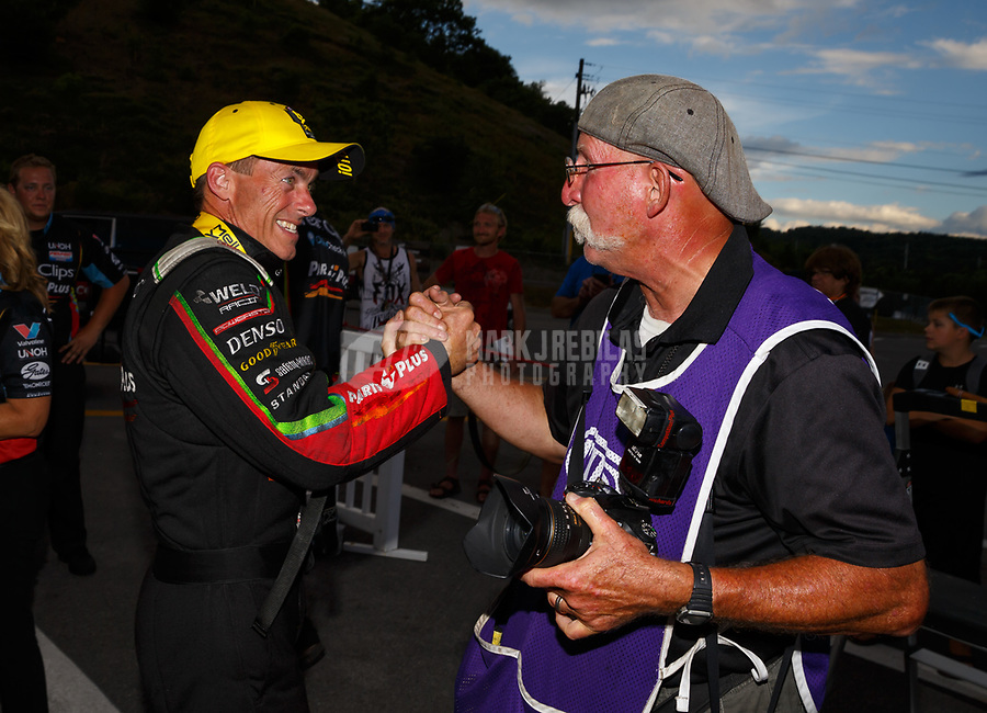 Jun 18, 2017; Bristol, TN, USA; NHRA top fuel driver Clay Millican (left) celebrates with photographer Roger Richards after winning the Thunder Valley Nationals at Bristol Dragway. Mandatory Credit: Mark J. Rebilas-USA TODAY Sports