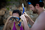 Mark Hartman, 34, right, helps his girlfriend Julia Le, 35, of San Jose, Calif., with her snorkel gear at Bai Nhat beach on Con Son Island, part of the Con Dao Islands.The 16 mountainous islands and islets are situated about 143 miles southeast of Ho Chi Minh City in Vietnam, in the South China. Photo taken Thursday, May 5, 2010...Kevin German / LUCEO For the New York Times