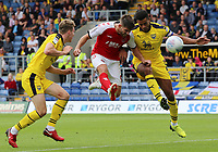 Fleetwood Town's Ched Evans beats Oxford United's Curtis Nelson to the ball and heads towards goal<br /> <br /> Photographer David Shipman/CameraSport<br /> <br /> The EFL Sky Bet League One - Oxford United v Fleetwood Town - Saturday August 11th 2018 - Kassam Stadium - Oxford<br /> <br /> World Copyright &copy; 2018 CameraSport. All rights reserved. 43 Linden Ave. Countesthorpe. Leicester. England. LE8 5PG - Tel: +44 (0) 116 277 4147 - admin@camerasport.com - www.camerasport.com