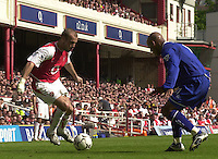 Premiership Football - Arsenal v Leicester City:.2003/04 Season - 15/05/2004  [Record breaking Season undefeated] .Fredrik Ljungberg, moving in from the wing, blocked by Jorden Stewart.[Credit] Peter Spurrier Intersport Images