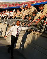 Ohio State University football coach Urban Meyer greets fans while taking the field before Saturday's NCAA Division I football game against Wisconsin at Ohio Stadium in Columbus on September 28, 2013. (Barbara J. Perenic/Columbus Dispatch)