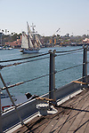 The tall ship Irving Johnson seen from the final voyage of the battleship USS Iowa from Berth 51 to its new home at Berth 87 in San Pedro, Los Angeles, CA where it opens as a museum ship in July 2012.