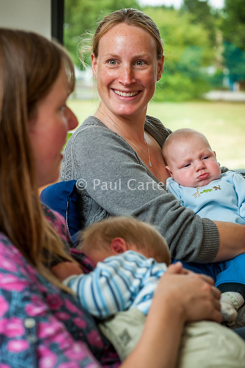 Breastfeeding mothers meet and chat at a drop-in breastfeeding support centre.<br /> <br /> 01/06/2011<br /> Hampshire, England, UK