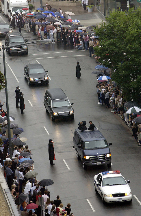 6/11/04.REAGAN FUNERAL MOTORCADE--The hearse containing the coffin of former President Ronald Reagan makes its way along 22nd Street N.W. on the way to the National Cathedral, where a state funeral service will be held. The motorcade began at the U.S. Capitol, where Reagan lay in state in the Rotunda for 34 hours..CONGRESSIONAL QUARTERLY PHOTO BY SCOTT J. FERRELL