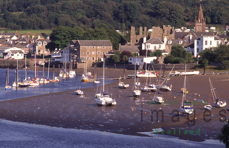 Kirkcudbright looking across the River Dee to yachts stranded on mud with town of Kirkcudbright behind Galloway Scotland UK