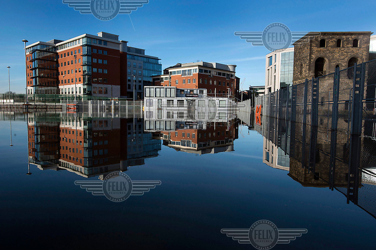 Flooding in Wellington Place in the business district of city centre Leeds after heavy rains over the Chirstmas holiday weekend.