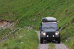 2011 Land Rover Defender 110 TD4 Hard Top crossing the unsurfaced Stol mountain pass from Sedlo to Zaga in the Julian Alps, Slovenia. --- No releases available, but releases may not be necessary for certain uses. Automotive trademarks are the property of the trademark holder, authorization may be needed for some uses. --- Note: This is a digitally modified image.