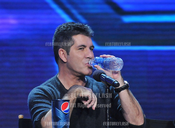 "Simon Cowell at the press conference for the season finale of Fox's ""The X Factor"" at CBS Televison City, Los Angeles..December 17, 2012  Los Angeles, CA.Picture: Paul Smith / Featureflash"