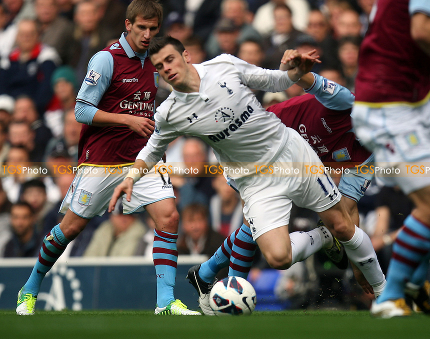 Gareth Bale of Tottenham Hotspur is brought down - Tottenham Hotspur vs Aston Villa at the White Hart Lane  Stadium  - 07/10/12 - MANDATORY CREDIT: Dave Simpson/TGSPHOTO - Self billing applies where appropriate - 0845 094 6026 - contact@tgsphoto.co.uk - NO UNPAID USE.