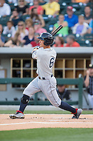 Zach Walters (6) of the Columbus Clippers follows through on his swing against the Charlotte Knights at BB&T BallPark on May 27, 2015 in Charlotte, North Carolina.  The Clippers defeated the Knights 9-3.  (Brian Westerholt/Four Seam Images)
