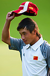 SHENZHEN, CHINA - OCTOBER 29:  Ren Han of China acknowledges spectators on the 17th green during the day one of Asian Amateur Championship at the Mission Hills Golf Club on October 29, 2009 in Shenzhen, Guangdong, China.  (Photo by Victor Fraile/The Power of Sport Images) *** Local Caption *** Ren Han