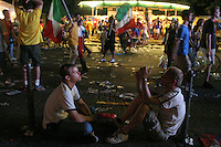 Some fans relax after watching the 2006 FIFA World Cup final match on large outdoor public screens at the FIFA World Cup Fan Fest in Tiergarten park in Berlin. The game was held at the Olympic Stadium in Berlin, Germany on Sunday July 9th, 2006. Italy won on penalty-kicks, 5-3, over France after the match ended up in a draw in regulation and extra time