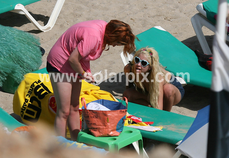 **ALL ROUND EXCLUSIVE PICTURES FROM SOLARPIX.COM**.**WORLDWIDE SYNDICATION RIGHTS**.Peaches and Fifi Geldof relaxing on the beach in Ibiza, where Peaches has been DJing in clubs while on her summer break. The wild-child daughter of Boomtown Rat Bob Geldof and the late Paula Yates looked relaxed as she sunbathed topless with her sister by her side..JOB REF:  4437   AB1        DATE:  05.08.07.**MUST CREDIT SOLARPIX.COM OR DOUBLE FEE WILL BE CHARGED* *UNDER NO CIRCUMSTANCES IS THIS IMAGE TO BE REPRODUCED FOR ANY ONLINE EDITION WITHOUT PRIOR PERMISSION*