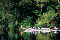 793050265 a small group of ecotourists make their way along the carrao river in a motorized canoe on their way to view angel falls in a remote section of canaima national park venezuela