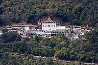 Myanmar, Burma.  Shwe Oo Min Pagoda and Entrance to Cave  on Hillside, Pindaya, Shan State.