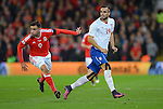 Dusan Tadic of Serbia is challenged by Neil Taylor of Wales during the FIFA World Cup Qualifying match at the Cardiff City Stadium, Cardiff. Picture date: November 12th, 2016. Pic Robin Parker/Sportimage