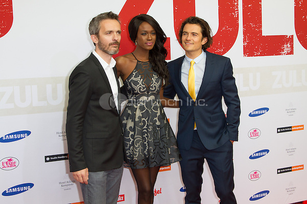 Jerome Salle, Joelle Kayembe and Orlando Bloom attending the Zulu premiere held at Cinemaxx Dammtor, Hamburg, Germany, 05.05.2014. <br /> Photo by Christopher Tamcke/insight media /MediaPunch ***FOR USA ONLY***